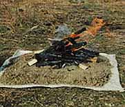 Use a Fire Blanket or Fire Pan to prevent scarring the ground with a campfire.